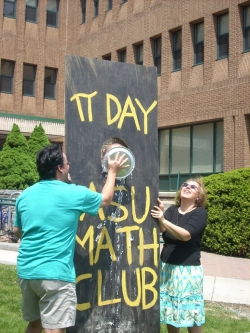 Pi Day celebration with pie in the face of faculty members