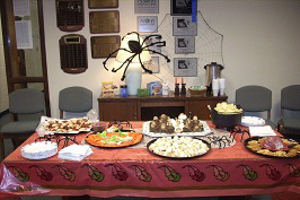 Department Tea table decorated for Halloween and covered with food platters